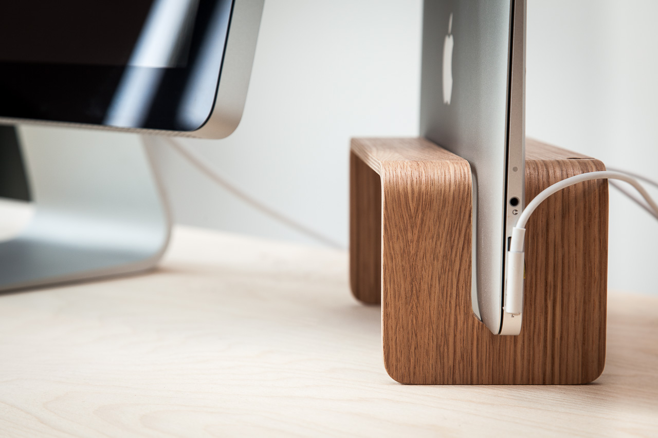 Vertical MacBook stand on desk
