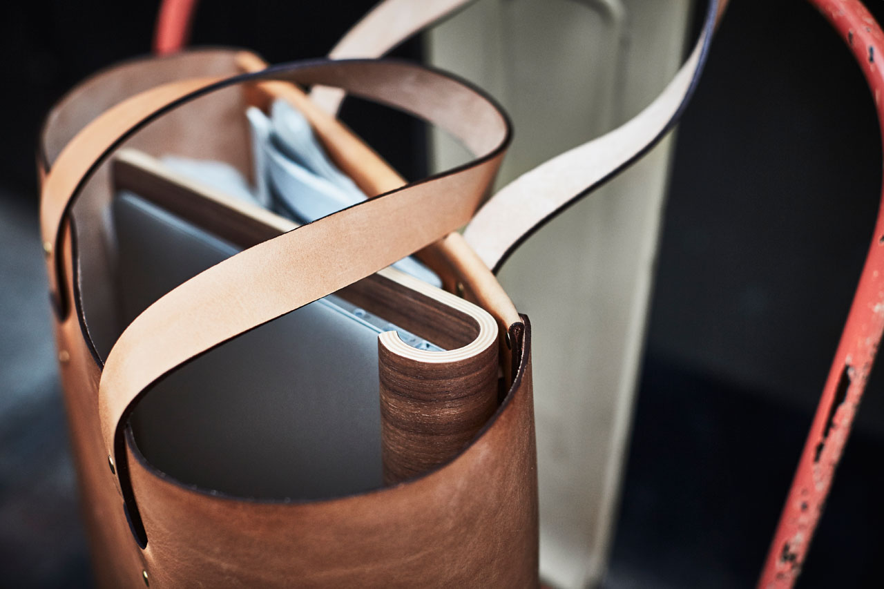 MacBook stand in leather bag